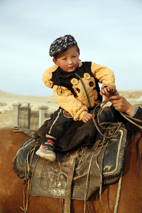 little boy on horse, Mongolia