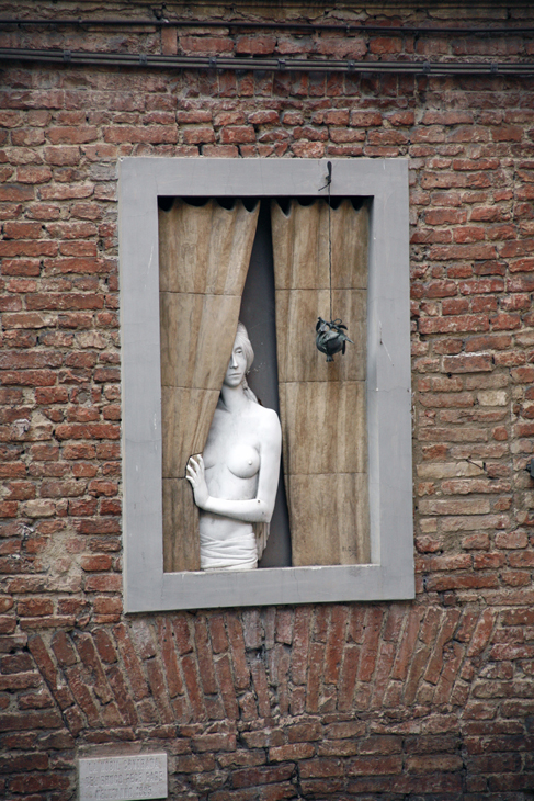 nude in window, Siena, Italy